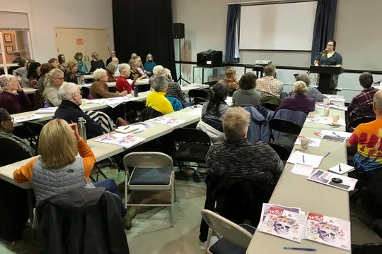 Attendees at a forum on death on Feb. 1, 2020, at the Bainbridge Island Senior Community Center listen to a presenter.