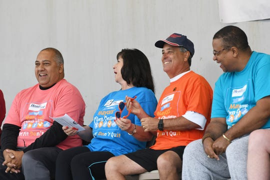 """Cocoa Beach Mayor Ben Malik, Melbourne Mayor Kathy Meehan, West Melbourne Mayor Hal J. Rose and Palm Bay Mayor William Capote share a laugh during the kickoff of the 2020 Mayor's Fitness Challenge in Viera. Mayors of 11 different towns throughout Brevard County have assembled teams of citizens and invited them to participate in the challenge, which measures the number of minutes exercised by each team. The team with the most minutes wins a trophy and bragging rights for the next year as the """"Most Fit City 2020""""."""