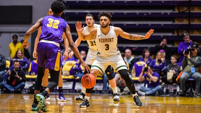 Vermont's Anthony Lamb defends during Saturday's America East game at Albany. Lamb scored 33 points in the Catamounts' 86-75 win.