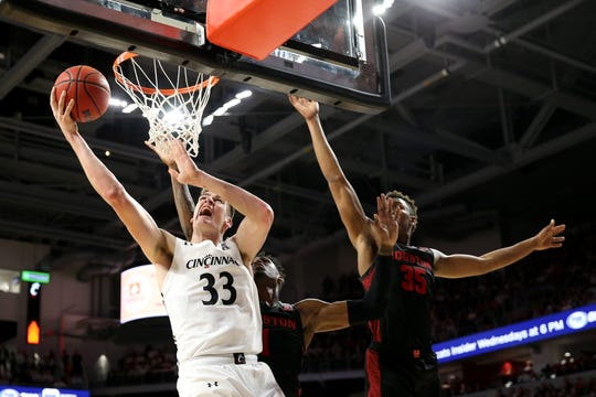 Cincinnati Bearcats center Chris Vogt (33) goes up for a basket as Houston Cougars forward Fabian White Jr. (35) defends in the first half during a college basketball game, Saturday, Feb. 1, 2020, at Fifth Third Arena in Cincinnati.