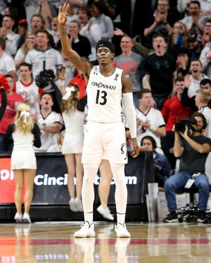 Cincinnati Bearcats forward Trevon Scott (13) gestures after scoring a 3-point shot in the second half during a college basketball game, Saturday, Feb. 1, 2020, at Fifth Third Arena in Cincinnati. Cincinnati Bearcats won 64-62.