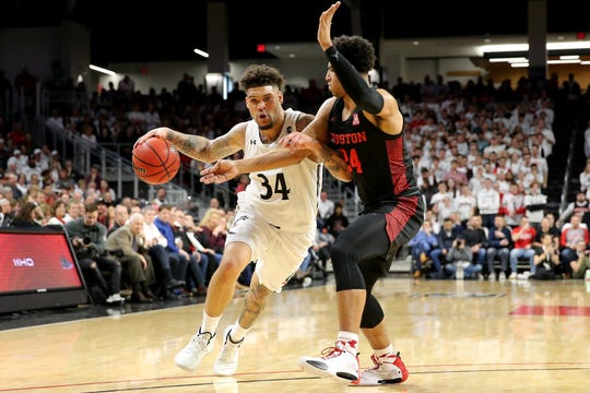 Cincinnati Bearcats guard Jarron Cumberland (34) drives to the basket as Houston Cougars guard Quentin Grimes (24) defends in the first half during a college basketball game, Saturday, Feb. 1, 2020, at Fifth Third Arena in Cincinnati.