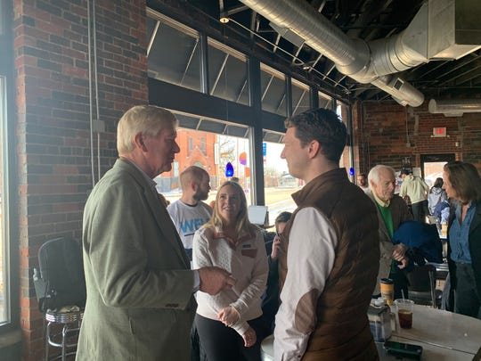 Presidential candidate Bill Weld speaks to Smokey Row customers in Des Moines on Feb. 2, 2020.