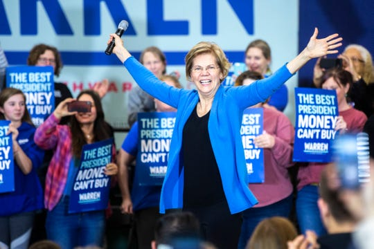 "Democratic presidential candidate U.S. Sen. Elizabeth Warren, D-Mass., waves while stepping on stage during a ""Get Out the Caucus Rally,"" Saturday, Feb. 1, 2020, at West High School in Iowa City, Iowa."