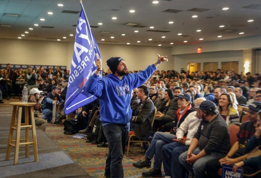 Emilio Medina leads a cheer for Democratic presidential candidate hopeful Andrew Yang at the Downtown Des Moines Marriott on Saturday. More than 1,200 supporters gathered to hear Yang speak in one of his final stops before the Iowa Caucus on Monday.