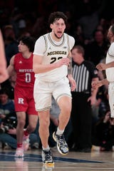 Michigan's Brandon Johns Jr. runs up court after scoring a basket during the second half vs. Rutgers, Saturday, Feb. 1, 2020, in New York.