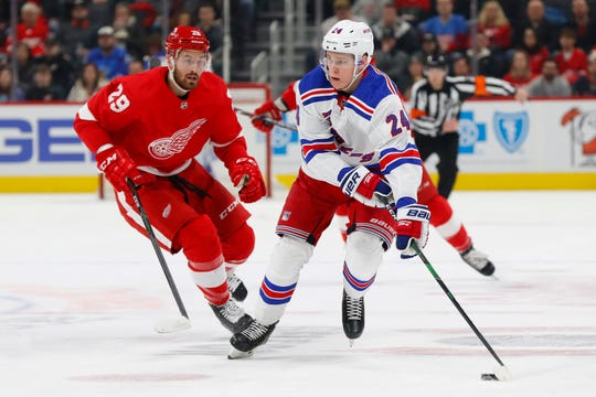 New York Rangers right wing Kaapo Kakko protects the puck from Detroit Red Wings left wing Brendan Perlini in the first period Saturday, Feb. 1, 2020, in Detroit.