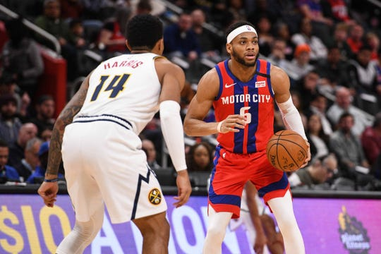 Detroit Pistons guard Bruce Brown looks to pass as Denver Nuggets guard Gary Harris during the first half at Little Caesars Arena, Feb. 2, 2020.