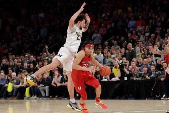 Rutgers's Caleb McConnell drives past Michigan's Brandon Johns Jr. during the second half Saturday, Feb. 1, 2020, in New York.