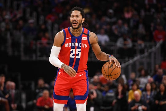 Detroit Pistons guard Derrick Rose brings the ball up court during the first quarter against the Denver Nuggets at Little Caesars Arena, Sunday, Feb. 2, 2020.