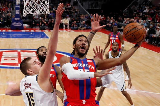 Detroit Pistons guard Derrick Rose attempts a layup as Denver Nuggets center Nikola Jokic defends during the first half Sunday, Feb. 2, 2020, in Detroit.