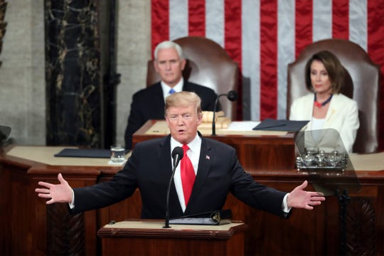 President Donald Trump delivers his State of the Union address Feb. 5, 2019, to a joint session of Congress on Capitol Hill in Washington, as Vice President Mike Pence and Speaker of the House Nancy Pelosi, D-Calif., watch.