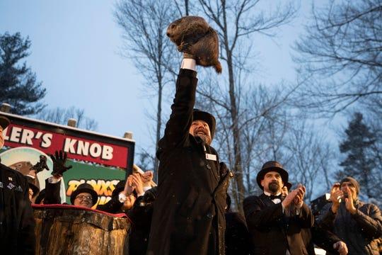 Groundhog Club co-handler Al Dereume holds Punxsutawney Phil, the weather prognosticating groundhog, during the 134th celebration of Groundhog Day on Gobbler's Knob in Punxsutawney, Pa., on Sunday, Feb. 2, 2020.