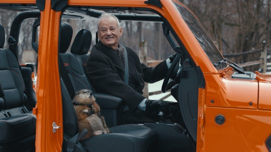"Actor Bill Murray recreates scenes from the 1993 ""Groundhog Day"" film with a Jeep Gladiator pickup truck in the brand's 2020 Super Bowl advertisement."