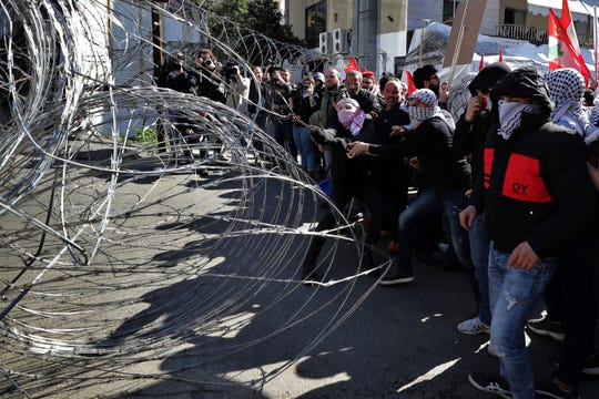 Hundreds of Lebanese and Palestinians demonstrated Feb. 2 near the U.S. embassy in Lebanon in rejection to a White House plan for ending the Israeli-Palestinian conflict. (AP Photo/Hassan Ammar)