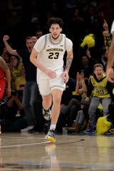 Brandon Johns Jr. makes a 3-pointer in the second half against Rutgers.