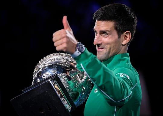Novak Djokovic gives a thumbs up after winning the Australian Open.