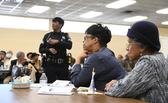 From left, Detroit Police Sgt. Terri Kennedy talks about different scenarios during an active attacker training session as attendees Paula Wardell of Oak Park and her mother, Mariel Wardell of Detroit, listen.