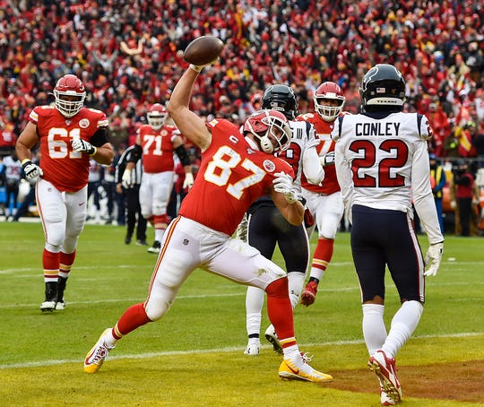 Kansas City Chiefs tight end Travis Kelce spikes the ball after scoring his first touchdown of the second quarter against the Houston Texans in the divisional playoff round.
