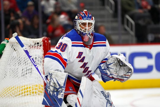 New York Rangers goaltender Henrik Lundqvist plays against the Red Wings in the second period.