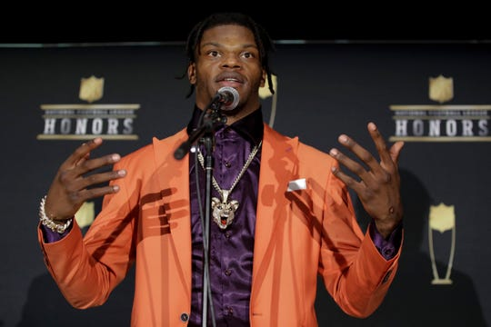 Baltimore Ravens' Lamar Jackson speaks after winning the AP Most Valuable Player award Saturday at the NFL Honors football award show in Miami.