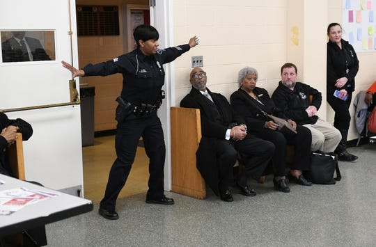 Detroit Police Sgt. Terri Kennedy talks about different scenarios during an active attacker training session at Second Baptist Church in Detroit Sunday.