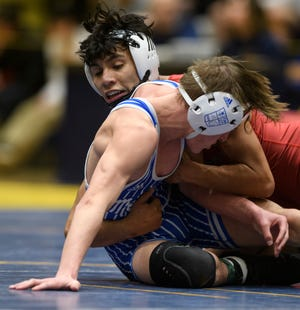 Heritage Hill's Sam Scott works to take down Memorial's Keegan Williams in the 120-pound championship match of the IHSAA Sectional tournament at Castle High School in Newburgh, Ind., Saturday, Feb. 1, 2020. Scott won the match after Williams forfeited because of an injury.