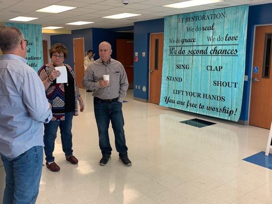 Audra and Tom Manzari, members of Restoration Christian Church, which meets at Ida Baker High School in Cape Coral, talk with pastor Rob Kendall before services Sunday. The Manzari's are in favor of proposed state legislation that would allow them to be armed during Sunday services.