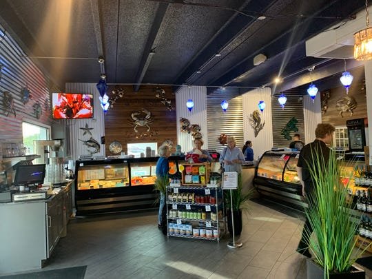 "Recently remodeled, Merrick Seafood sells fresh fish and a number of menu items from Fish Tale in the ""We Make You Bake"" section."