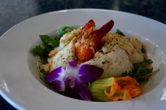 A plate of lobster-stuffed hogfish from Fish Tale Grill