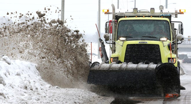 Eau Claire County snow plow driver David Gotlibson plows in Eau Claire, Wis., Monday, Jan. 22, 2020. Gotlibson is one of a few dozen county workers tasked with the sometimes draining, often unpredictable job of salting and plowing state and county roads during winter, the Leader-Telegram reported.
