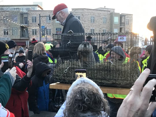 People crowd the stage to get a shot of Jimmy the Groundhog after the Groundhog Day Prognostication Event on February 2, 2020, in Sun Prairie, Wisconsin.