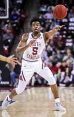 Feb 1, 2020; Columbia, South Carolina, USA; South Carolina Gamecocks guard Jermaine Couisnard (5) passes against the Missouri Tigers in the first half at Colonial Life Arena. Mandatory Credit: Jeff Blake-USA TODAY Sports