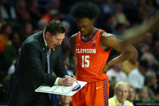 Feb 1, 2020; Winston-Salem, North Carolina, USA; Clemson Tigers head coach Brad Brownell talks with guard John Newman III (15) during the second half against the Wake Forest Demon Deacons at Lawrence Joel Veterans Memorial Coliseum. Mandatory Credit: Jeremy Brevard-USA TODAY Sports