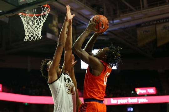 Feb 1, 2020; Winston-Salem, North Carolina, USA; Clemson Tigers guard Tevin Mack (13) shoots the ball against Wake Forest Demon Deacons center Olivier Sarr (30) during the second half at Lawrence Joel Veterans Memorial Coliseum. Mandatory Credit: Jeremy Brevard-USA TODAY Sports