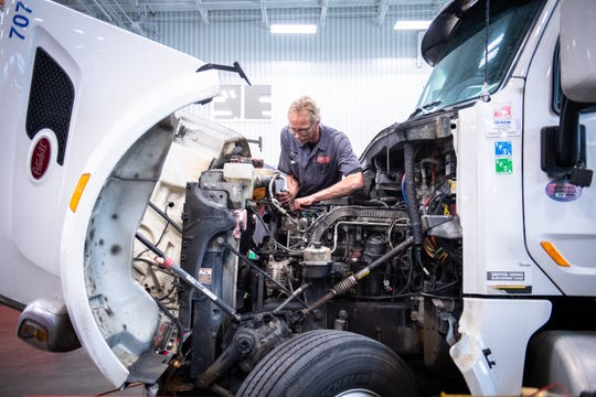 Richard Bennett, a diesel technician at the Peterbilt Store in Greenville, works on a truck engine Thursday, January 30, 2020.