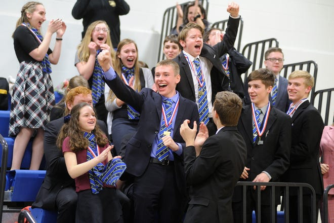The Great Falls Central Catholic Speech and Drama team reacts after finding out they had won the State Class B championship in speech and debate Saturday at Bigfork High School. Pictured from left are Theresa Voeller, Adrienne Purpura, Quin Pray (partially hidden), Mae Kimmel, Alexis Wigdorski, Kade Berderain, Lara Marin, Aiden Holden, Noah Schmit, Emerson Sheppard (back to camera), Antonio Jabsonson, David Marler, Colby Aderhold.