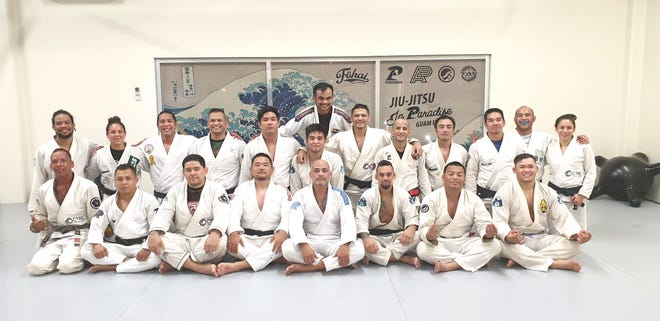 Purebred BJJ Guam recently awarded black belts to: William Escobar, second-degree; Ray Roberto, David Tuncap, Joshua Jerome, James Paek, Mike Sanchez and Eric Sian, first-degree. Back, standing: Oliver Cruz. Middle row, from left: David Harris, Brogan Sanchez, Ronnie Sanchez, Romeo Sanchez, Larrone Gandaoli, Allen Cepeda, James Roberto, RayPaul Jardon, Richard Enriquez, Frank Camacho, Tracy Matanane.Front, from left: Ray Roberto, Tuncap, Jerome, Paek, Stephen Roberto, Mike Sanchez, Escobar, Sian.