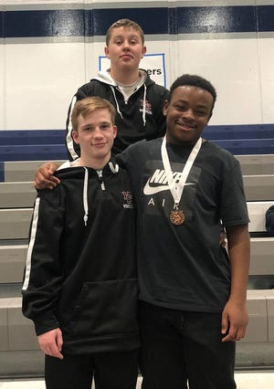 Henderson County wrestlers Conner Lander, back, Brendan Haire and Andre Hart placed in the JV state wrestling tournament Saturday in Louisville.