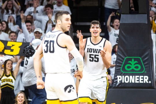 Iowa center Luka Garza (55) celebrates after making a 3-point basket during a NCAA Big Ten Conference men's basketball game, Sunday, Feb. 2, 2020, at Carver-Hawkeye Arena in Iowa City, Iowa.
