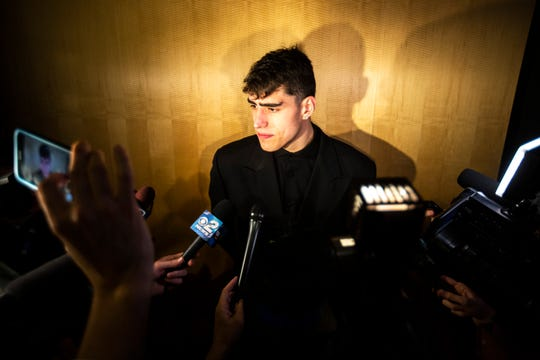 Iowa center Luka Garza is getting used to being surrounded by reporters these days. Here, he speaks after a Hawkeye home victory over Illinois on Feb. 2.