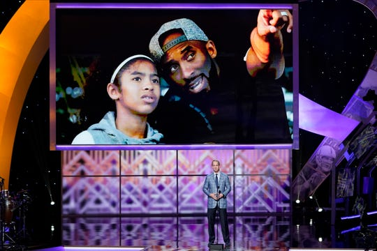 Former NFL quarterback Peyton Manning pays tribute to Kobe Bryant and his daughter Gianna at the NFL Honors football award show Saturday, Feb. 1, 2020, in Miami.