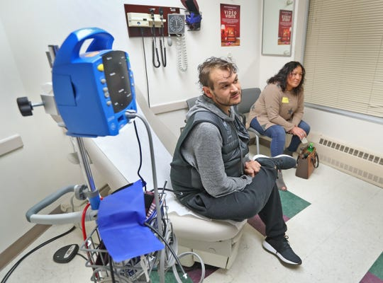 Jordon Mattingly, left, sits with his wife Gina Mattingly before his appointment in the digestive and liver disorders clinic at I.U. Health University Hospital, Wednesday, Jan. 29, 2020.  Doctors who specialize in diseases of the liver are noticing a disturbing trend -- an uptick in the number of patients who develop and die from alcohol-related disease.  Liver specialists are seeing younger and younger people show up in their exam rooms, and the disease is increasing far more rapidly for women than men.