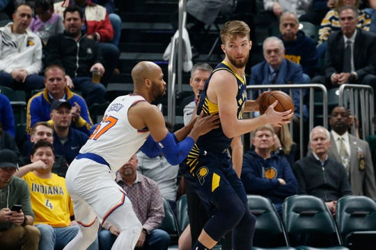 Indiana Pacers forward Domantas Sabonis (11) is guarded by New York Knicks center Taj Gibson (67) during the first quarter at Bankers Life Fieldhouse.