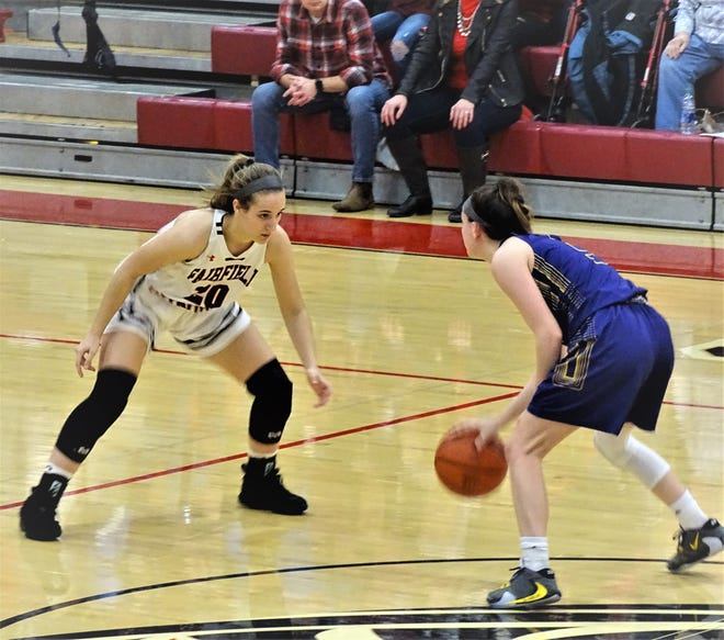 Fairfield Union sophomore Hannah Rauch locks in on defense against Bloom-Carroll's Makenzee Mason during the Falcons' 52-40 win Saturday night.