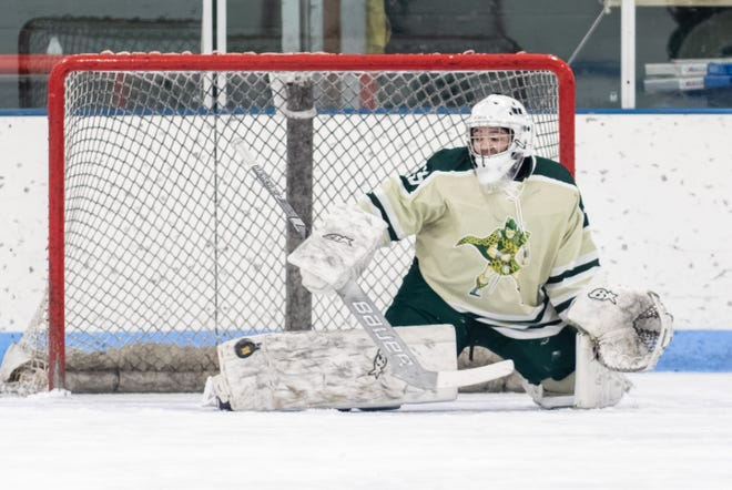 Howell's Ean Badgett makes one of his 28 saves in a 3-2 overtime loss to Livonia Stevenson on Saturday, Feb. 1, 2020.