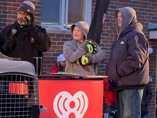 Paul James, left, of iHeartMedia Marion prepares to announce Buckeye Chuck's official forecast for Groundhog Day 2020. Chuck did not see his shadow on Sunday and is predicting an early spring for Ohio. Buckeye Chuck's handlers from Kokas Exotics of Prospect had Chuck on stage as James read the forecast.