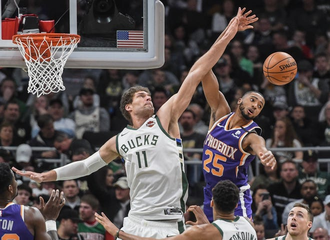 Milwaukee Bucks center Brook Lopez (11) and Phoenix Suns forward Mikal Bridges (25) battles for a rebound in the third quarter at Fiserv Forum on Feb. 2, 2020 in Milwaukee, Wisconsin.