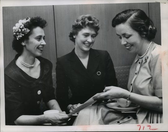 Mary Ellen Philipp, center, discusses business details with two other women in 1958. Philipp was involved in several civic organizations and charitable causes, often focused on the arts.