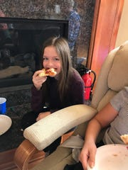 Eleven-year-old Marissa Roskopf samples pizza during a taste test of grocery store take-and-bake pizzas.